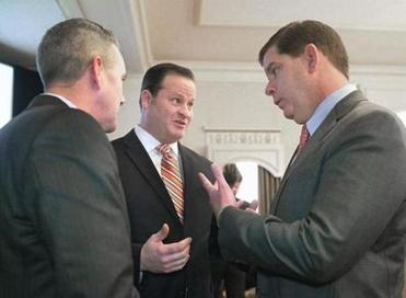 State Senator Michael Rush (left) and MassBio president Robert Coughlin spoke with Mayor Martin Walsh Wednesday.